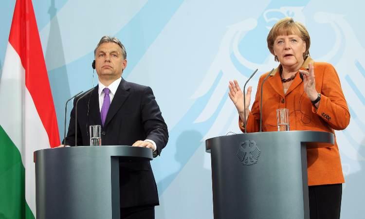 Viktor Orban e Angela Merkel