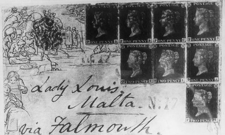 Una serie di francobolli attaccati ad una cartolina