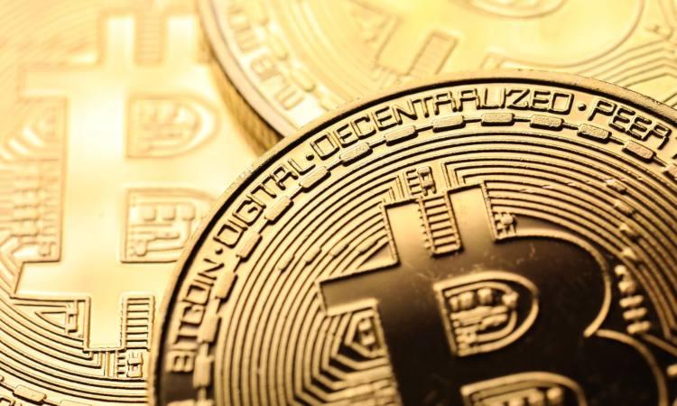 Alcune monete dorate dei Bitcoin