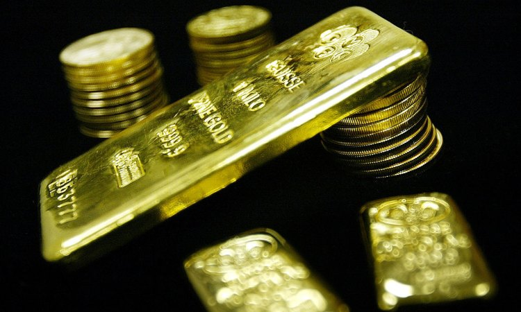 Alcune monete d'oro e un po' di lingotti