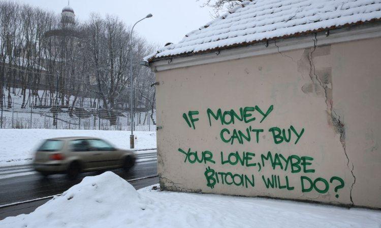 Una scritta su un muro dedicata ai Bitcoin