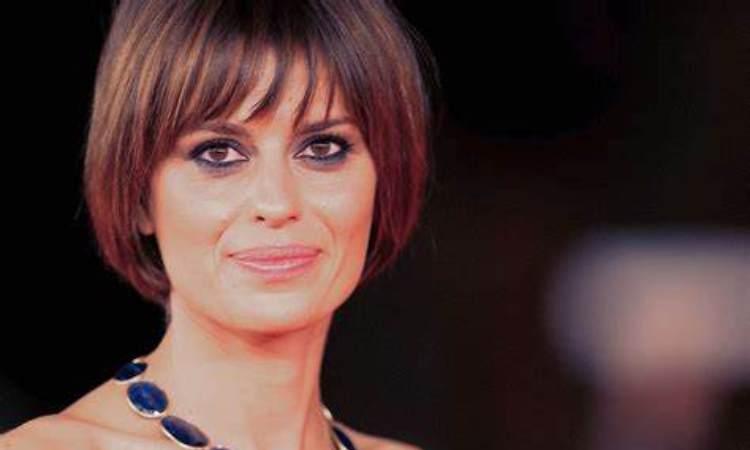 Claudia sorride