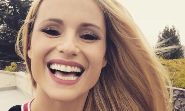 Michelle sorride